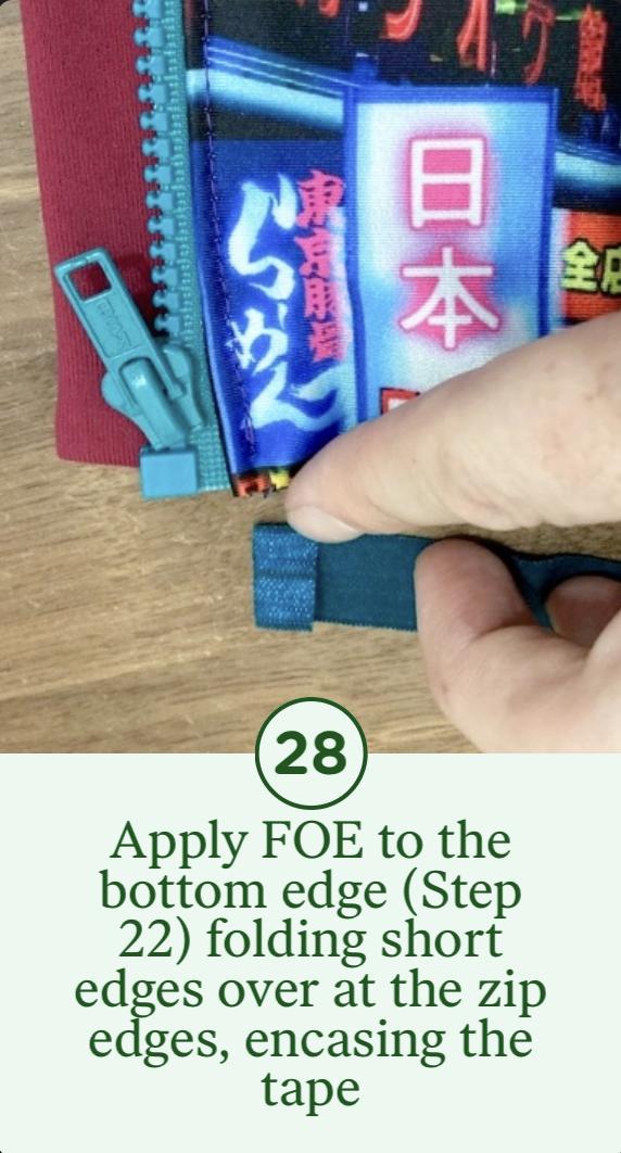28- Apply FOE to the bottom edge (Step 22) folding short edges over at the zip edges, encasing the tape